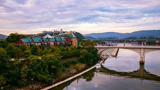 A view of the Tennessee River, as it runs under a bridge, alongside Chattanooga.
