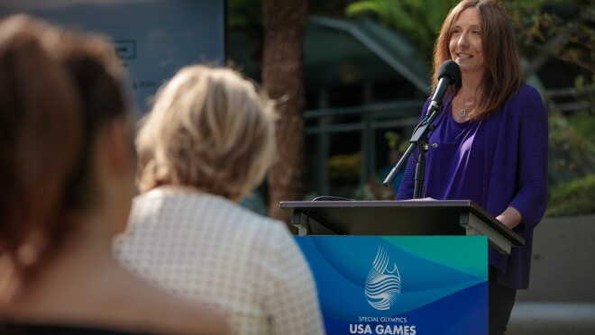 Beth Galetti, senior vice president of human resources, announces ways customers and Amazonians can support the upcoming USA Games.