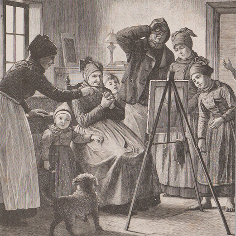An etching shows a group of adults and children gathered around an easel holding an unseen painting. There is a small dog at the people's feet.