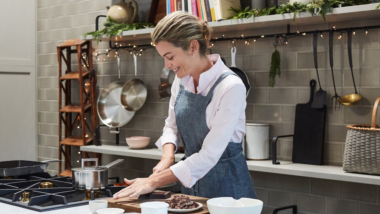 An image of KDP cookbook author, Virginie Degryse, cooking in her home kitchen.