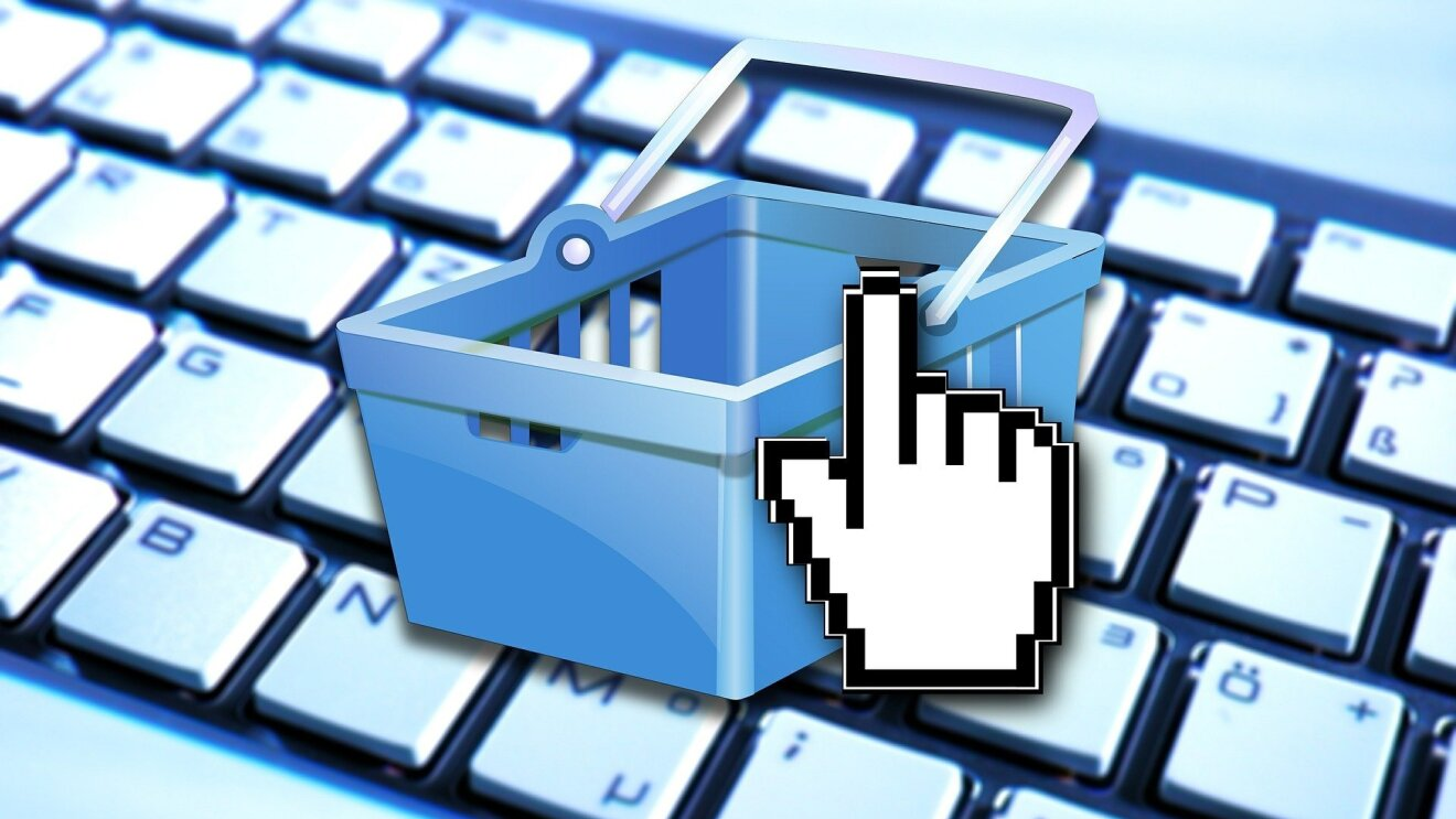 An image of a shopping cart on a keyboard depicting e-commerce