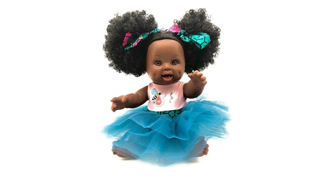 An image of a baby doll with a large blue tutu on