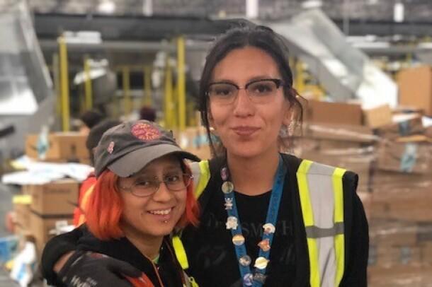 Amazon associates at San Bernardino pose for photos during Cyber Monday.