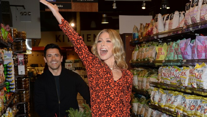 An image of Kelly Ripa and her husband, Mark Consuelos, hosting a holiday party for Delivering Smiles.