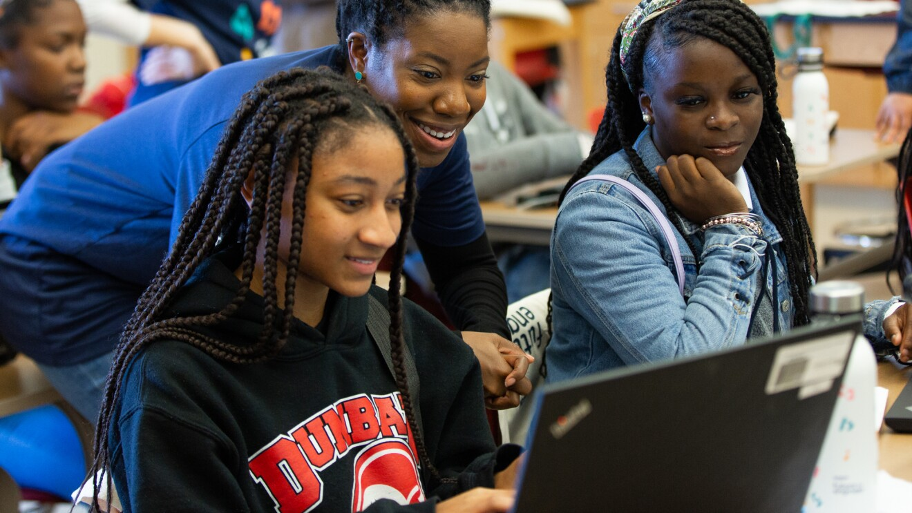 Amazon employee volunteers work on coding projects with students at Dunbar High School in Washington, DC to celebrate Amazon Future Engineer's 2,000 high schools milestone.