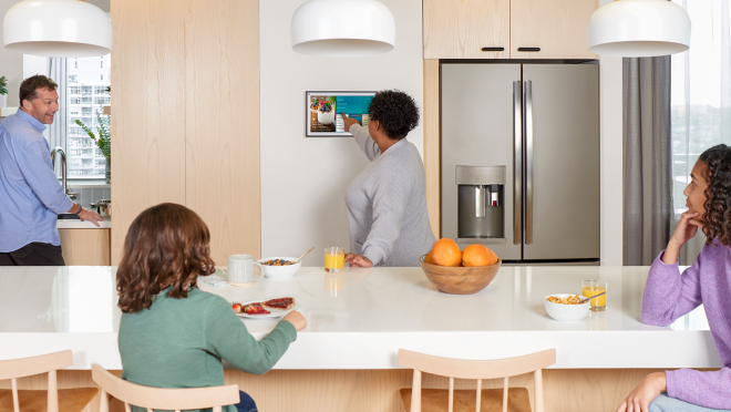 An image of a family eating breakfast in their kitchen.