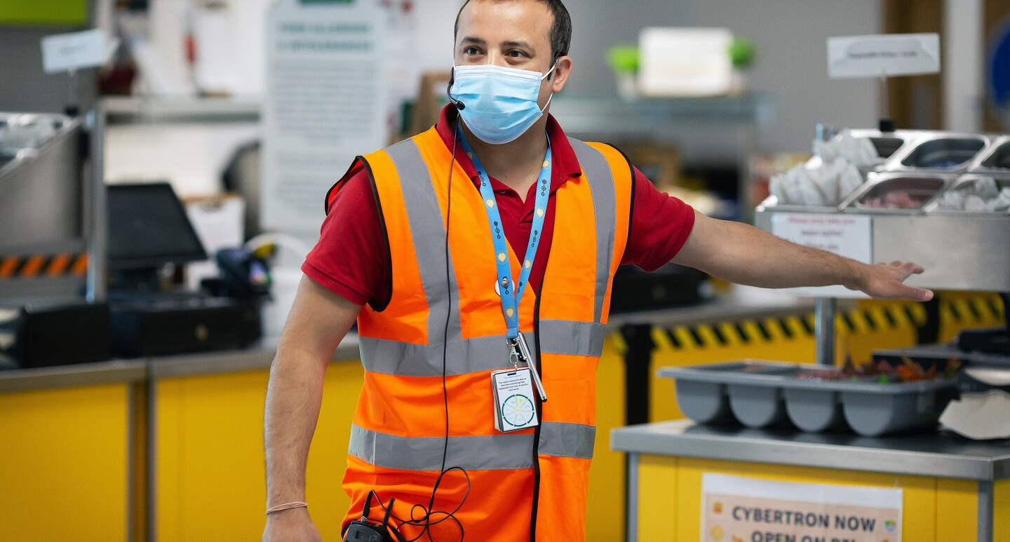 Amazon employee, Aman Thukral, wears a face mask and gives a tour of the new safety measures in fulfilment centres.