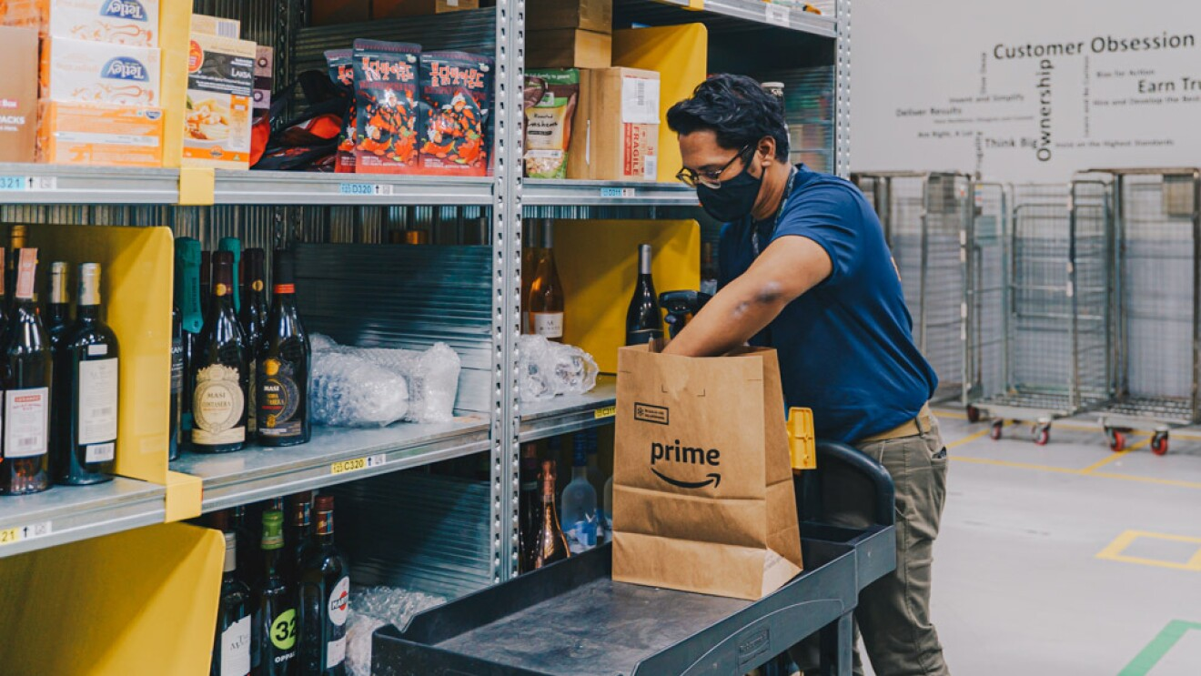 An employee packing an Amazon Fresh order in the fullfilment centre in Singapore