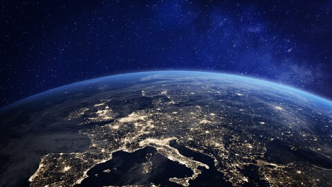 Europe at night, viewed from space with city lights showing human activity in Germany, France, Spain, Italy, and other countries.