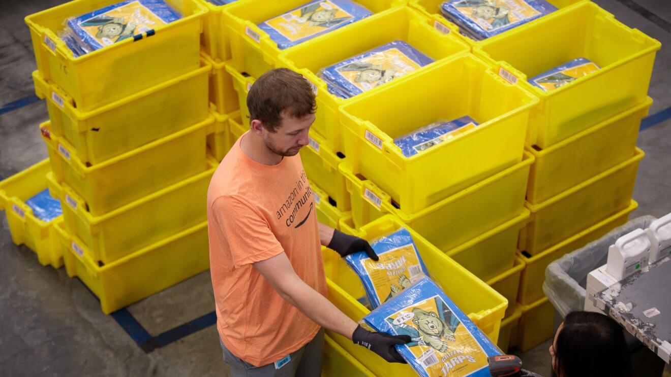 Amazon associates prepare items to distribute in the aftermath of Hurricane Dorian.