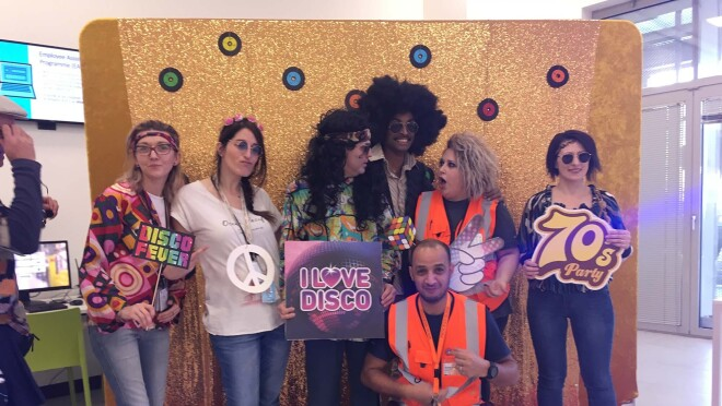 Amazon associates in our Milan fulfillment center participate in a 70s theme