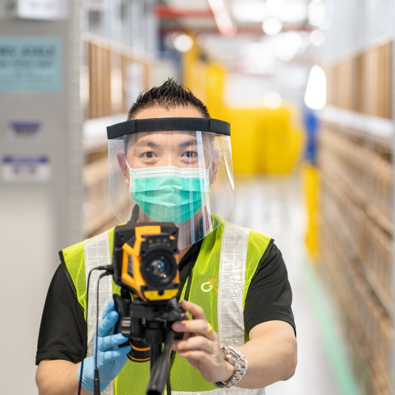 Amazon Singapore employee with safety measure in our fulfillment centre