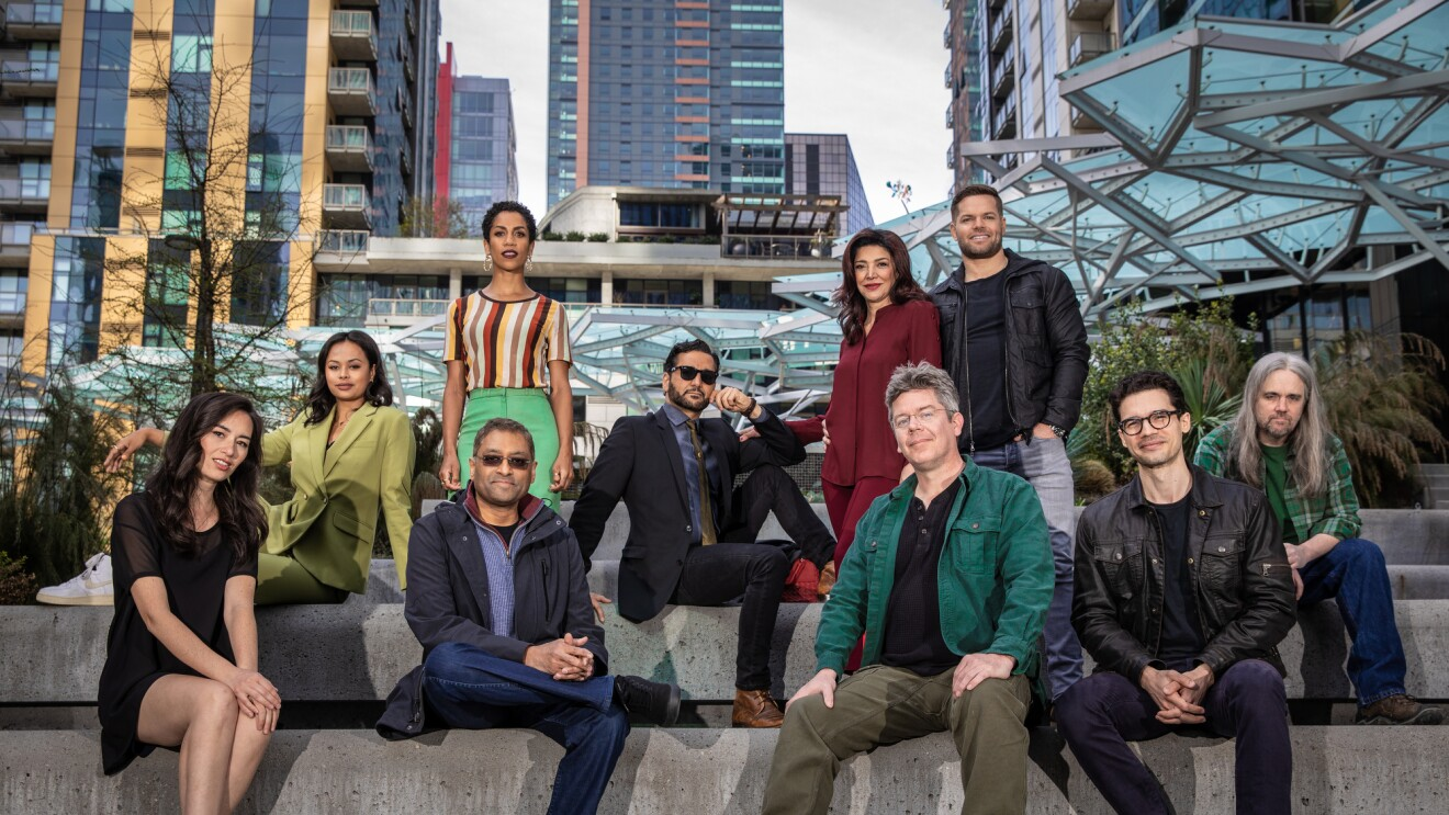The cast and crew from The Expanse in front of The Spheres on the Seattle Amazon campus.