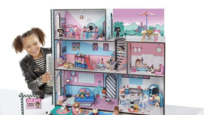 Wooden, multi-story house (three feet tall & three feet wide) with interactive features including working elevator, lights and sounds across the three floors; real pool, spa and sandbox, includes L.O.L Surprise! exclusive Family (Doll, Lil Sister, Pet).
