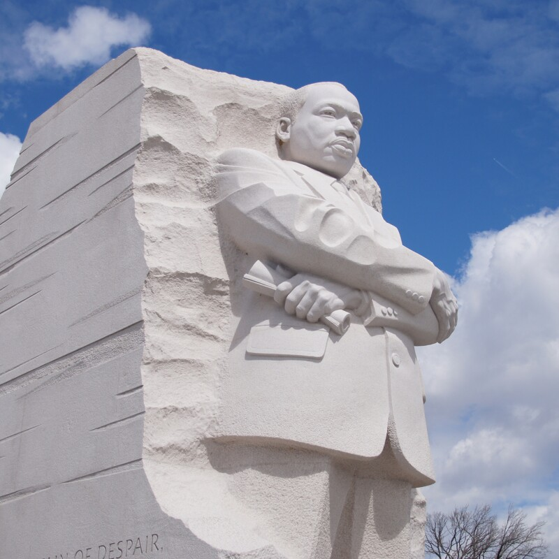 An image of the Martin Luther King Jr. monument with a blue sky and in the background.