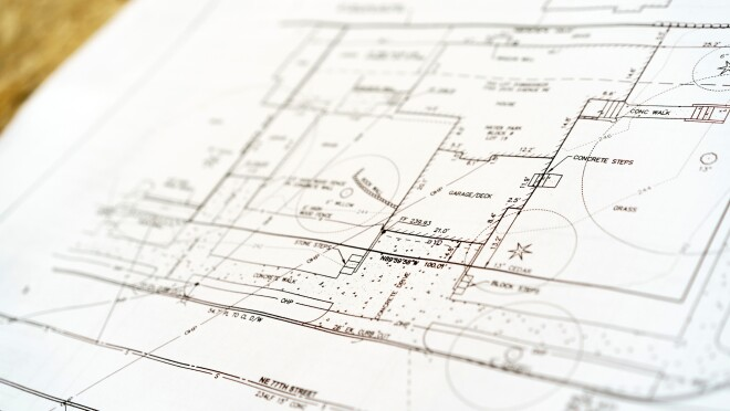 A blueprint of a home construction project, showing concrete steps, garage and living spaces.