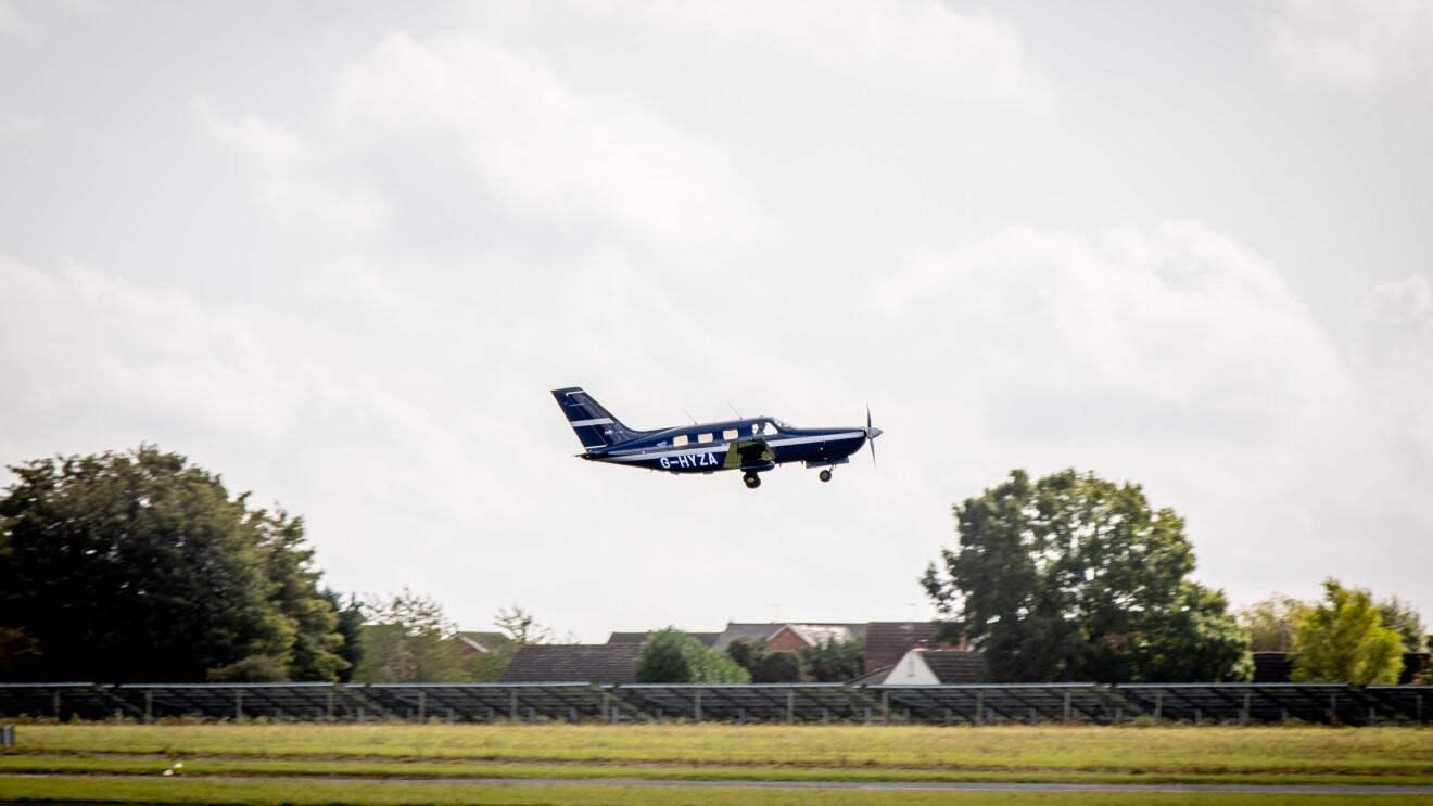 A small plane taking off or landing on a small airfield.