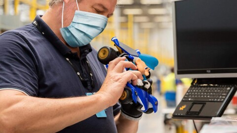 An Amazon employee prepares a toy to be resold or donated