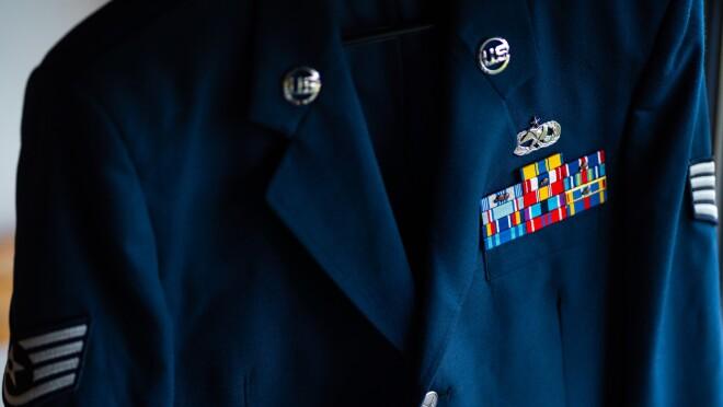 A blue blazer with military insignia.
