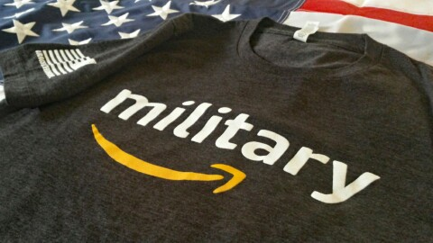 "An image of a shirt with that shows the word ""military"" above the Amazon logo."