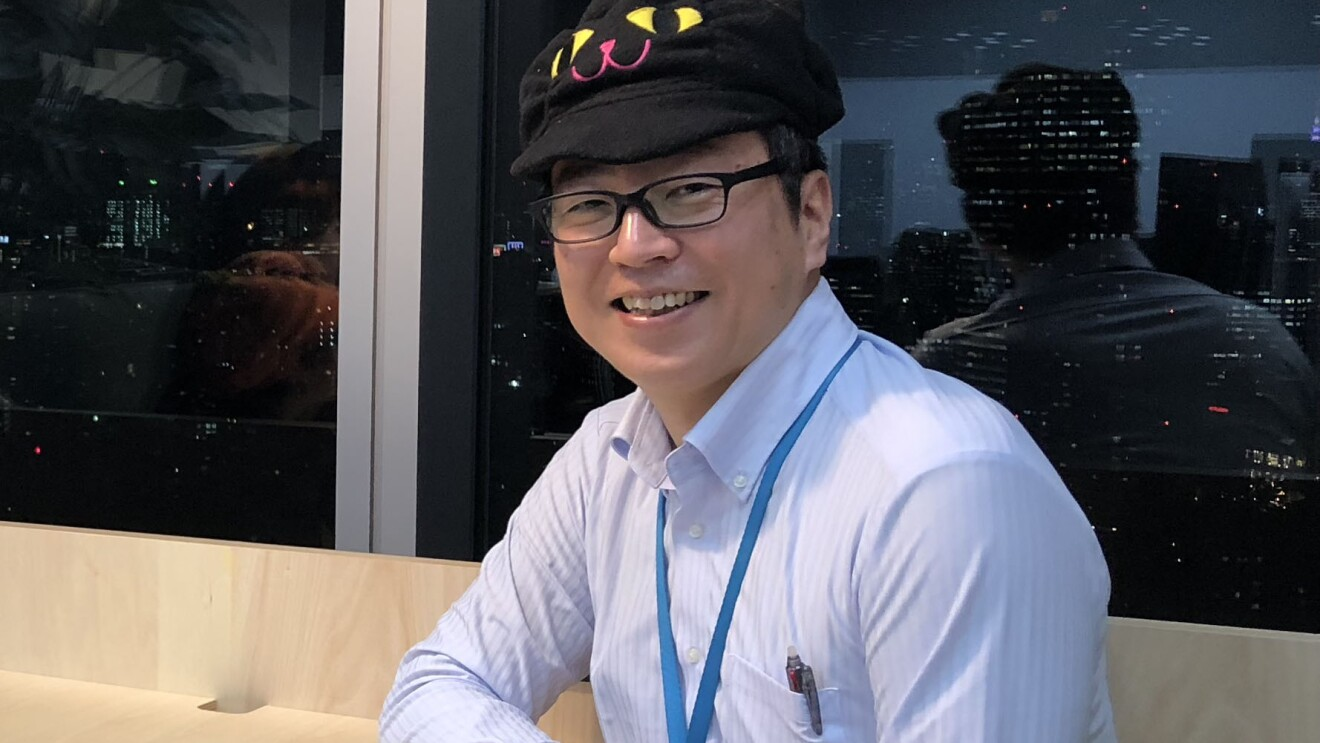 Noboru Obata, a Senior Account Manager on the Amazon Prime team and Co-Chair of the PwD Japan affinity group, smiles for a photo.