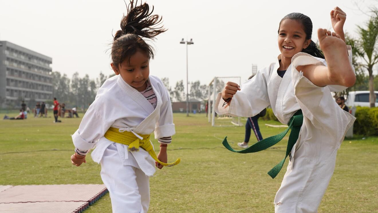Two girls practicing Martial Arts