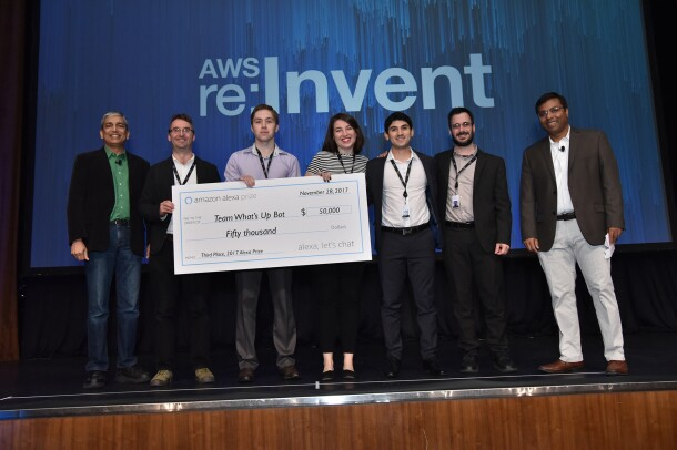 Amazon Alexa Prize students from Team What's Up Bot hold a $50,000 prize check.