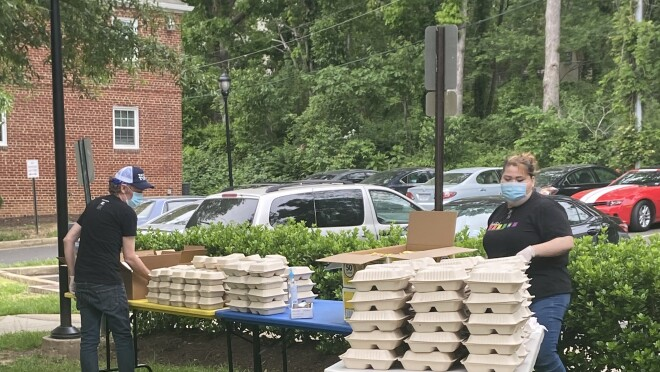 Amazon donates meals to local rescue workers and employs local restaurant Freddie's Bar and Grill in their HQ2 location to prepare the meals