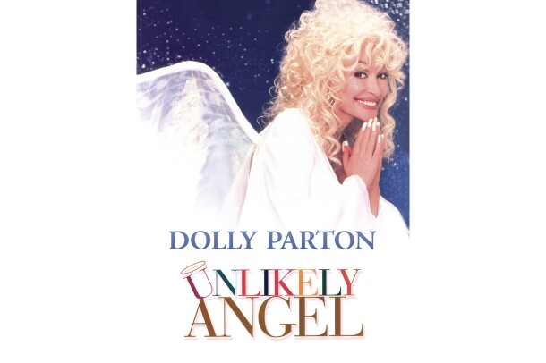 "Cover art for ""Unlikely Angel"" features Dolly Parton, with her hands together as if to pray, while looking to the side and smiling at the camera. She wears her hair curly with bangs, a white robe and angel wings."