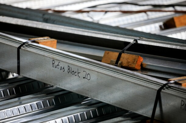 "Buildings under construction on Amazon's South Lake Union campus. a beam with ""Rufus Block 20"" scribed on it."