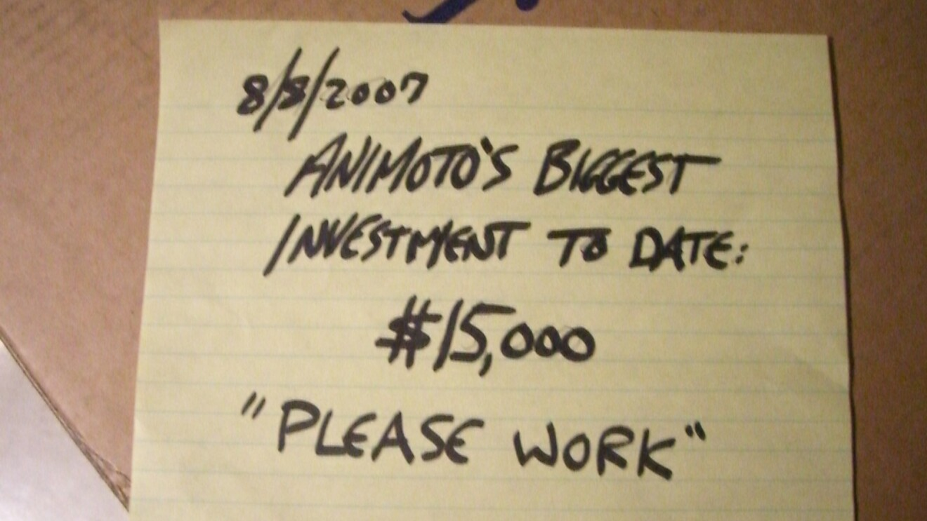 """An image of a sticky note that has the date """"8/8/2007"""" on it and says """"Animoto's Biggest investment to date: $15,000 'please work'"""""""