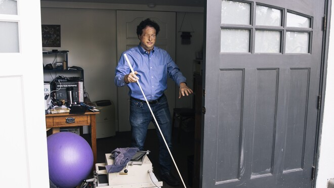Josh Miele, Principle Accessibility Researcher at Amazon Lab126, exits his home office.