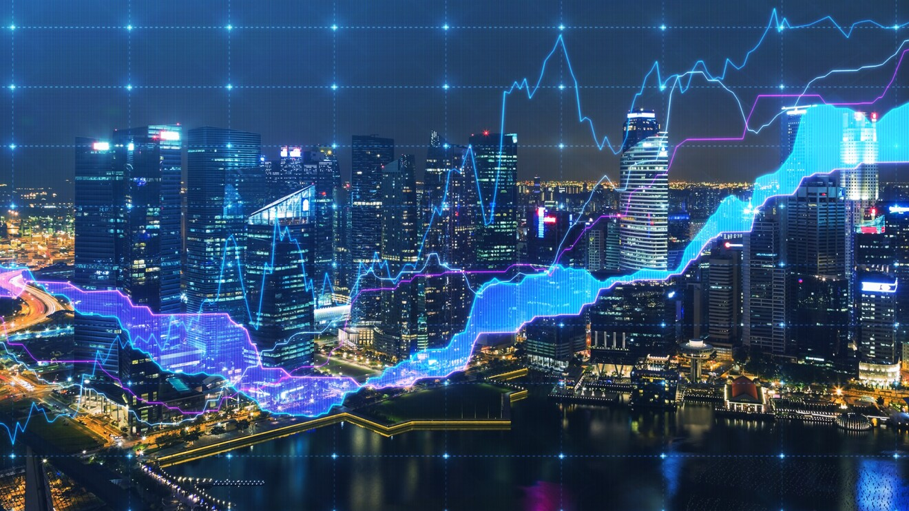 Nighttime view of Singapore, with graphs overlaying the city