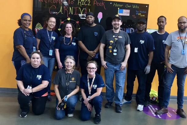 Amazon associates from Chester, VA show off their Peak T-shirts