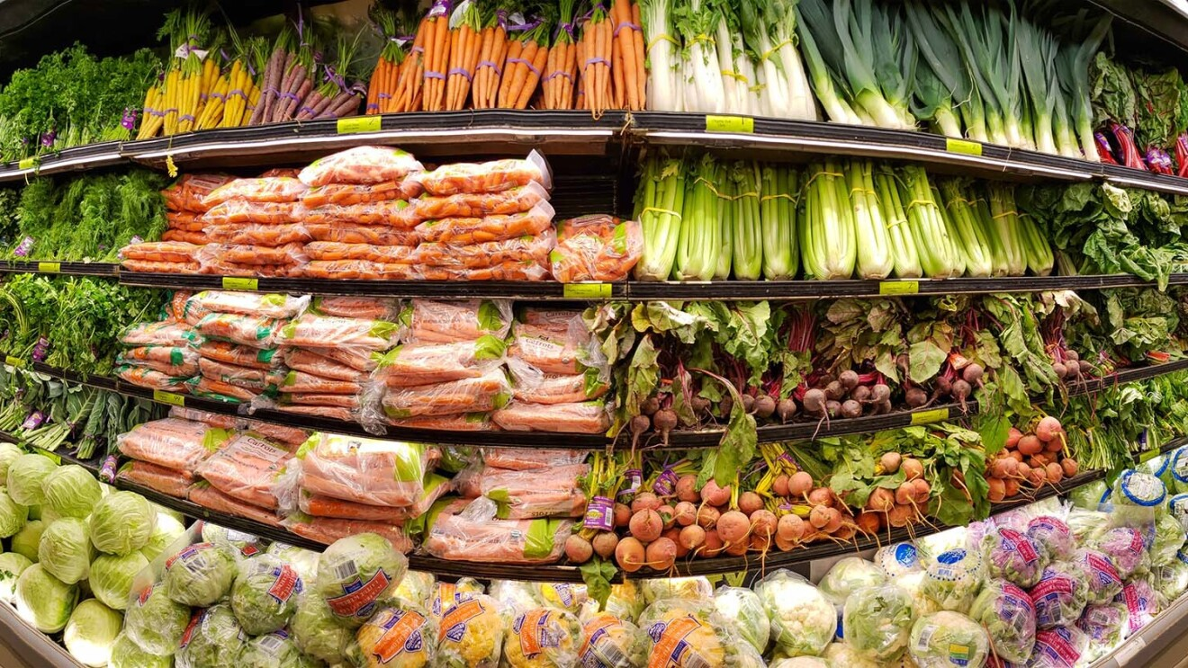 A panoramic image of a produce section in a Whole Foods Market store.