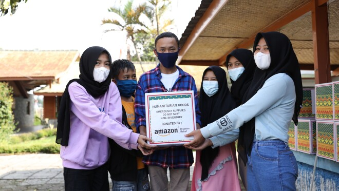 Families in Cipanas, Indonesia receiving grocery kits
