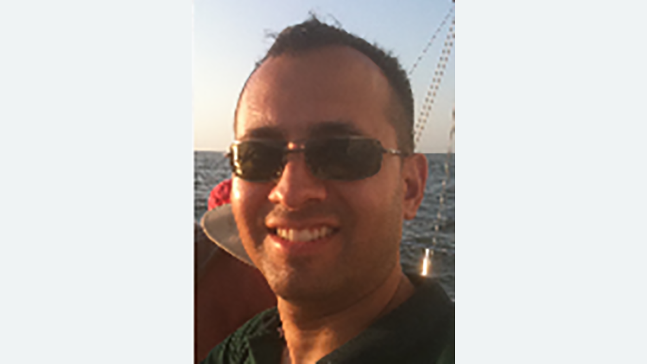 Headshot of a male Amazon employee
