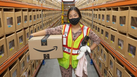 Associate wearing her PJs for Amazon Goes Gold
