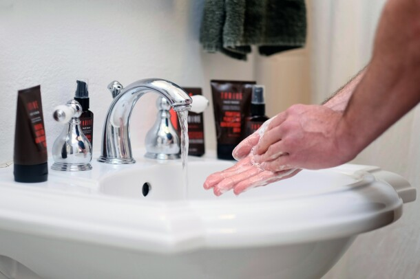 A man using Thrive Natural Care shave and skin-care products
