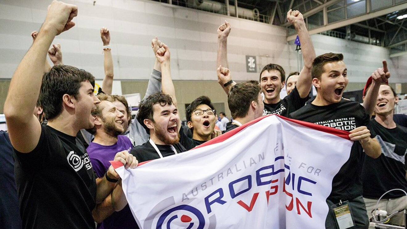 A group of Australian students cheer after winning the Amazon Robotics Challenge.