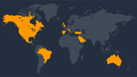 A dark blue image of an international map with bright orange colors highlighting some countries.