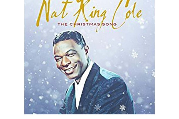 "Nat King Cole wears a suit, facing the camera with a smile. The background is a blue-gray and appears to fade from light to darker gray-purple. Snow falls around him, with snowflakes in front of him. Nat King Cole is scrawled across the top in gold, with ""The Christmas Song"" in red, below."