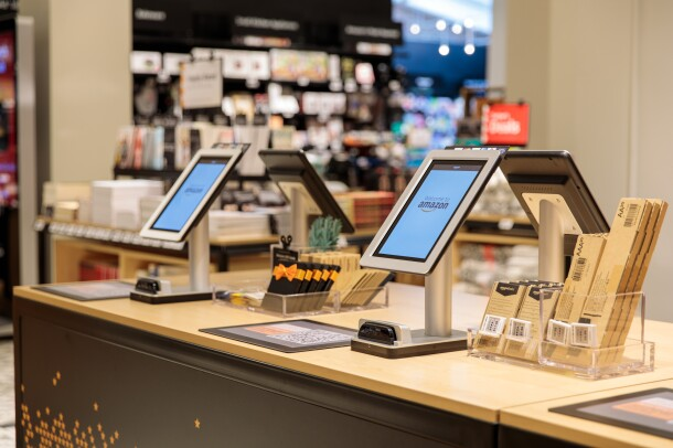 Checkout kiosks at the Amazon 4-star store. The four checkouts include a tablet, card reader, barcode to scan from the Amazon app, along with batteries and Amazon gift cards.