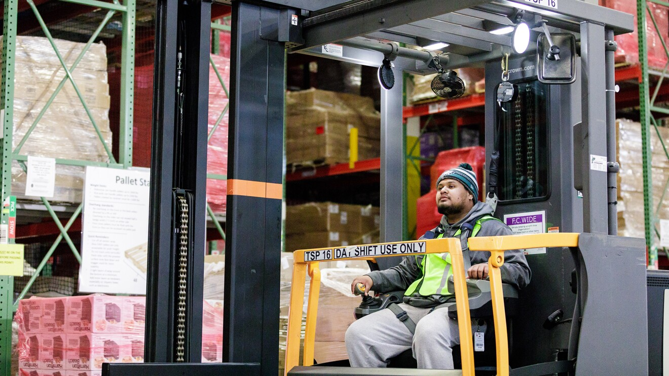 An Amazon employee drives a forklift at BFI3 in DuPont, WA