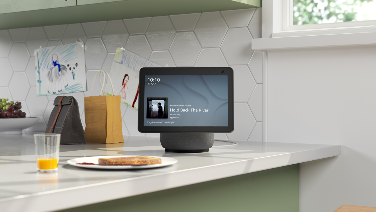 An image of an Alexa Show sitting on a kitchen counter top.