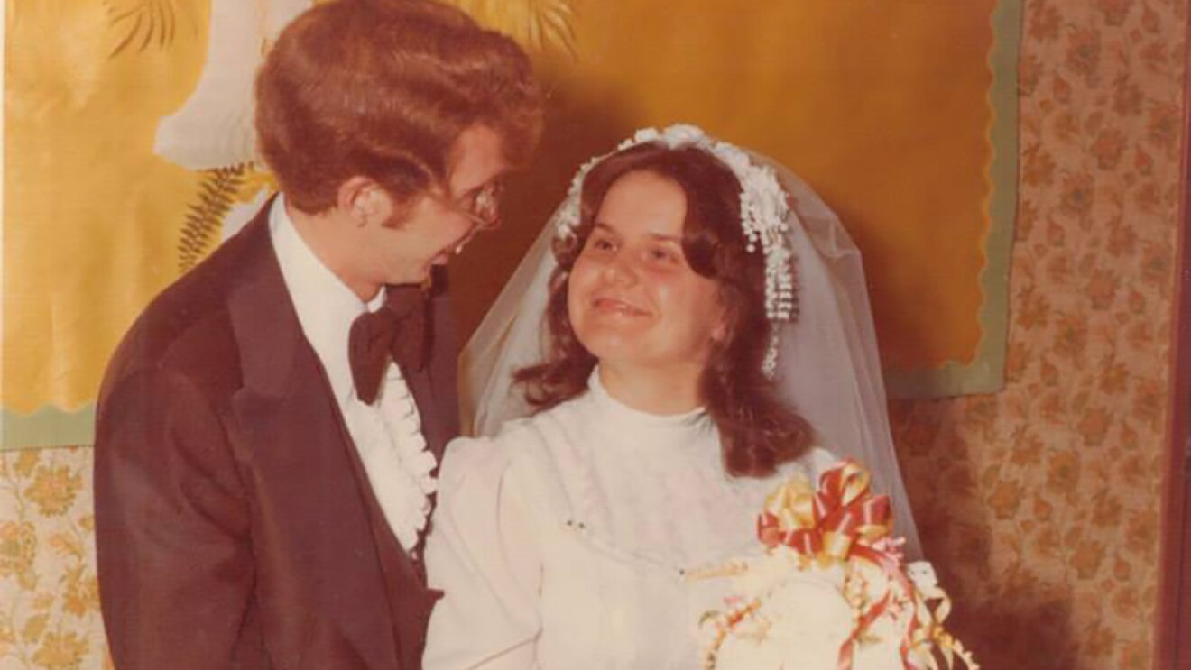 Vintage photograph of a young man and woman at their wedding, more than 30 years ago