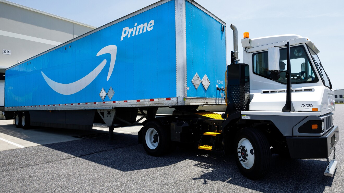 Amazon trailer arrives at the airport carrying more than 2,000 Amazon boxes – each box is part of a Prime member's order.
