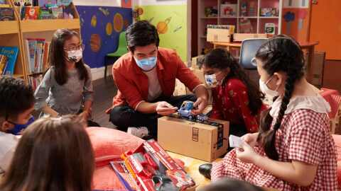Nathan Hartono interacts with children from Club Rainbow Singapore