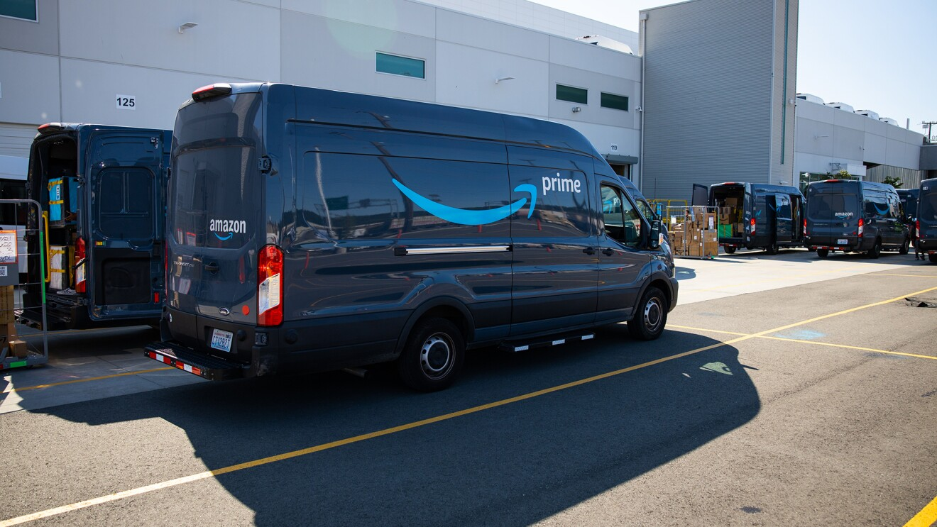 Amazon vans lined up and ready to gather and deliver customer orders