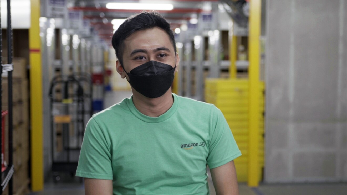 Amazon associate Farid Bin Rojion talks about his journey with Amazon against the backdrop of Amazon's fulfillment center in Singapore